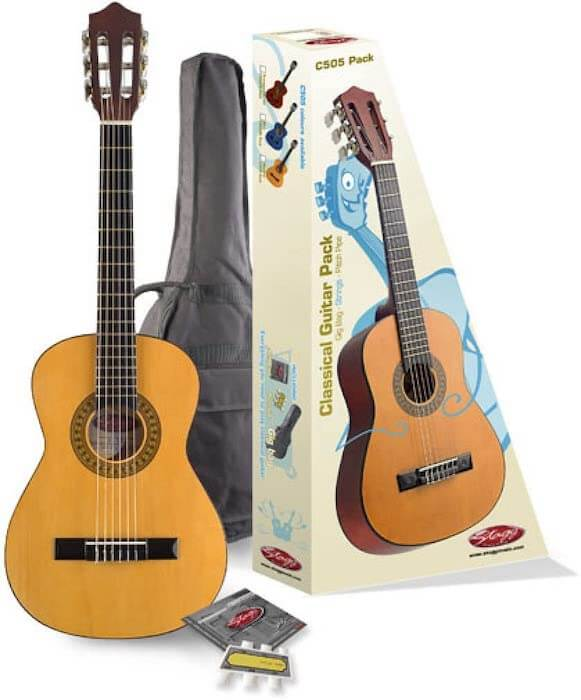 """A 32"""" Stagg C505 Guitar, a cardboard box, a gig bag, and spare strings"""